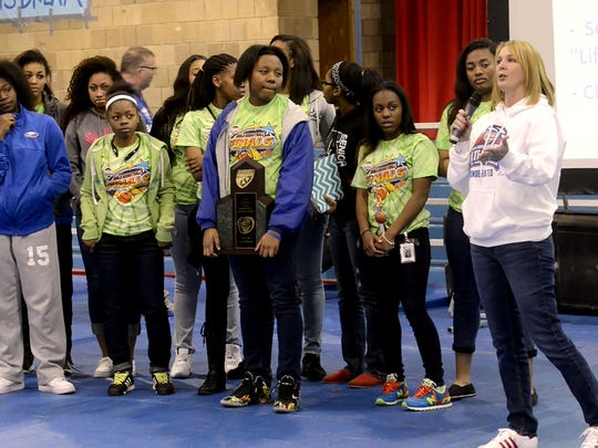 Pine Forest High School coach Chris Godwin and her team are recognized during a Black History program Friday in the school gymnasium.