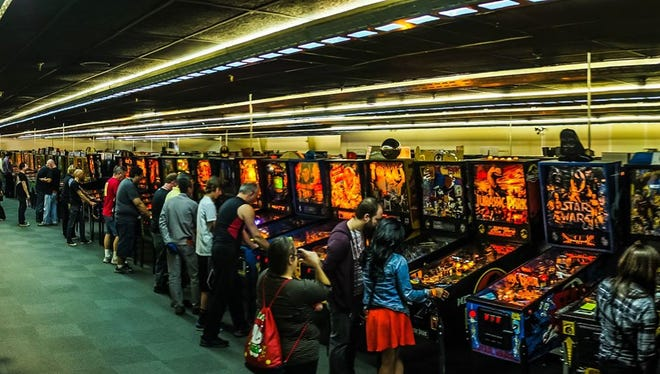 Gamers play pinball at 2015's Arcade Expo in Banning.