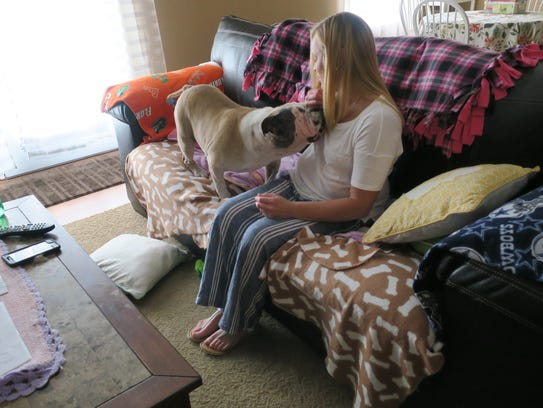 Boo Boo the bulldog gives owner Jennifer Montgomery