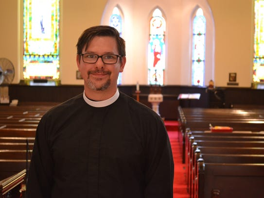 Deacon in Charge Matt Wahlgren stands inside St. Paul's