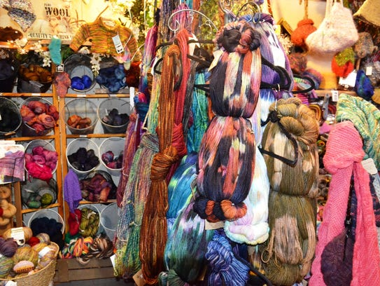 The yarn shop is packed with brightly colored skeins