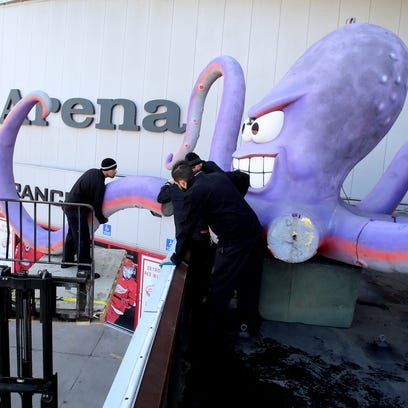 Olympia Entertainment workers assemble one of the tentacles