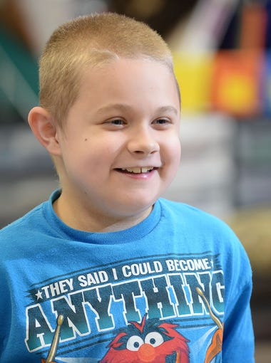 Silver Run student Conner Dill, 9, is all smiles in his classroom, Tuesday, Dec. 15 in Millville.  There is a fundraiser this Friday to benefit Dill, who has autism and muscular dystrophy.