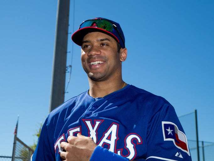 Seattle Seahawks quarterback Russell Wilson visits the Texas Rangers for a day at Surprise Stadium.