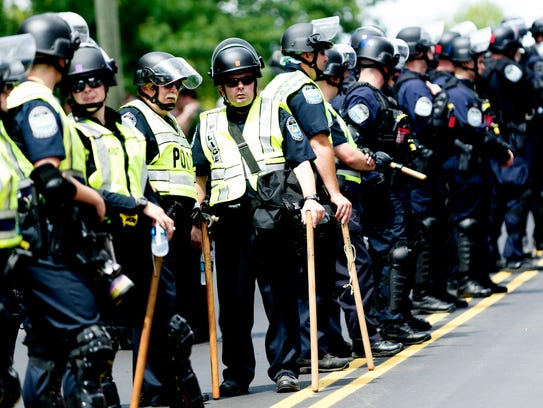 Knoxville Police officers stand guard during a protest