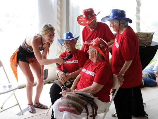 Natalie Labriola interviews Laddie Neil, left, Alice Ann Barge, Nancy Lee Pitts and Mary Neiderhauser about the group getting free VIP tickets into Bonnaroo Music and Art Festival on Saturday June 13, 2015.