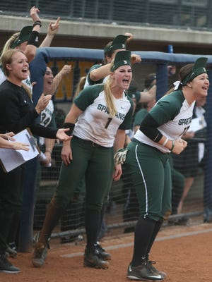 The Michigan State Spartans celebrate a hit during the sixth inning against Ohio State during the Big Ten softball tournament at Alumni Field in Ann Arbor on Saturday, May 13, 2017.