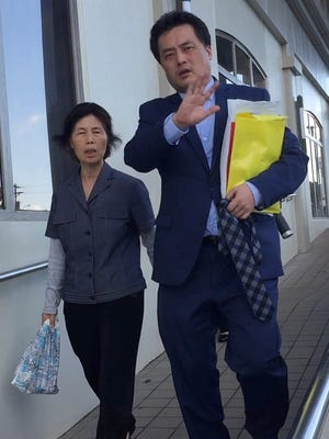 Yang Young Hwa, left, mother of Kwon Woo Sung, right, leave the District Court of Guam on Nov. 29, 2016, after Kwon was sentenced to almost three years in prison.
