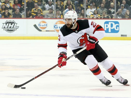 New Jersey Devils right wing Kyle Palmieri (21) carries