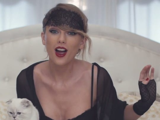 Taylor Swift holds her cat, Olivia Benson, in the video