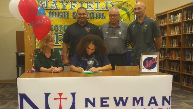 Mayfield's Kendra Butler, bottom right, signed to played basketball for Division II Newman University in Wichita, Kansas on Thursday afternoon.