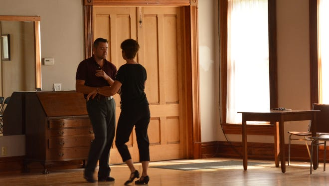 Instructor Jay Ruest leads a lesson with Suki Grossman in June at Tango Cafe Dance Studio.