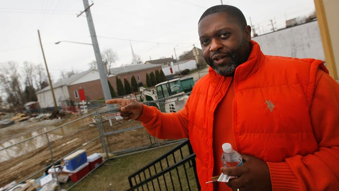 The Rev. Chris Curry, of Ezion Fair Baptist Church in Wilmington, points to the location of a future expansion on Monday.