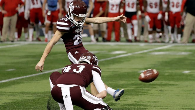 Mississippi State kicker Westin Graves (25) kicks a field goal against Miami (Ohio) during the second half of the St. Petersburg Bowl NCAA college football game Monday, Dec. 26, 2016, in St. Petersburg, Fla. Mississippi State won the game 17-16. Holding is Logan Cooke. (AP Photo/Chris O'Meara)