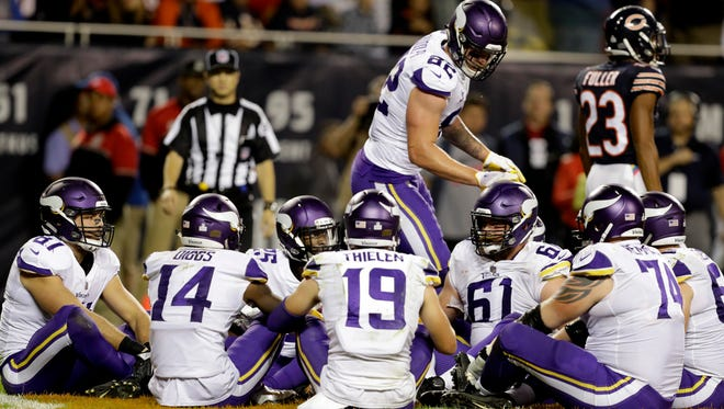 """FILE - In this Monday, Oct. 9, 2017, file photo, Minnesota Vikings tight end Kyle Rudolph (82) celebrates a touchdown with his teammates during the second half of an NFL football game against the Chicago Bears in Chicago. Rudolph initiated a humorous group celebration of his touchdown catch on Monday night with a brief rendition of the children's game """"Duck, Duck, Goose"""" in the end zone. Except in Minnesota, the only state where this is the case, the game is called """"Duck, Duck, Gray Duck."""""""