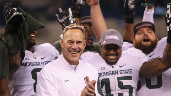 Michigan State Spartans head coach Mark Dantonio celebrates after the 16-13 win against the Iowa Hawkeyes in the Big Ten Championship on Dec. 5.