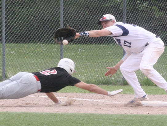 Churchill's Drew Alsobrooks dives safely back to first