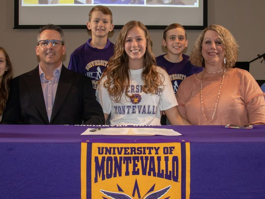 TCA's Savannah Lee (center) signed with the University of Montevallo last week.