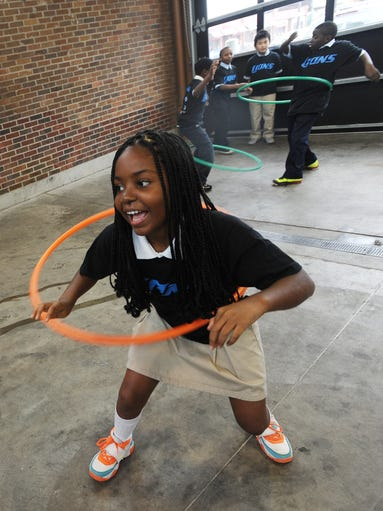 Lura Lindsey, 10, hula hoops with her classmates during