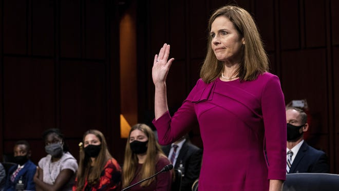 Supreme Court nominee Amy Coney Barrett is sworn in during her Senate Judiciary Committee confirmation hearing on Capitol Hill in Washington, D.C., on Monday, Oct. 12.