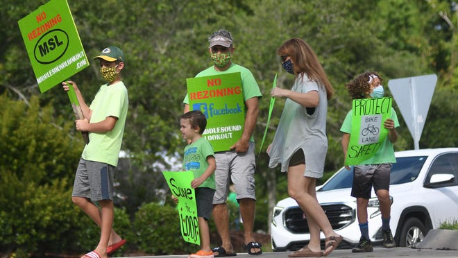 Residents of the Middle Sound neighborhood protested against a proposed development in front of Ogden Elementary School in Wilmington, N.C, Saturday, July 11, 2020, ahead of the July 13 meeting.