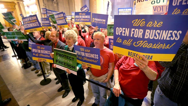 Supporters and opponents of Senate Bill 1010, the religious freedom bill, stand outside the House chambers on Thursday at the Indiana Statehouse.