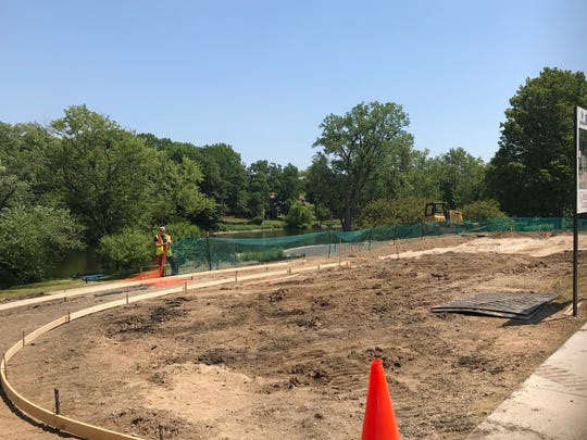 A splash pad under construction along the Grand River