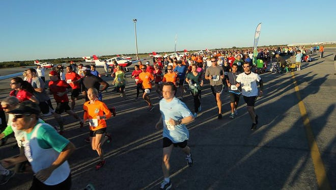 Runners take off from the starting line at the FLORIDA TODAY Corporate 5K.