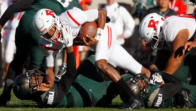 Rutgers quarterback Tylin Oden, center, is tackled by Michigan State's Andrew Dowell, left, and Robert Bowers, right, during the fourth quarter of an NCAA college footballl game, Saturday, Nov. 12, 2016, in East Lansing, Mich. (AP Photo/Al Goldis)