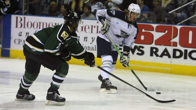 Ice Flyers' Michael Budd goes for the puck Sunday against the Mississippi Riverkings at the Pensacola Bay Center.