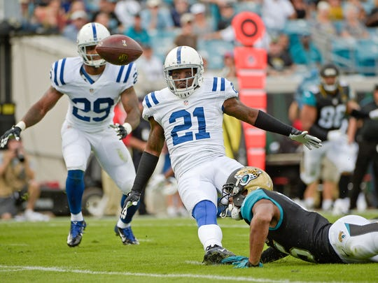 Indianapolis Colts cornerback Vontae Davis (21) breaks up a pass intended for Jacksonville Jaguars wide receiver Allen Robinson, right, during the first half of an NFL football game in Jacksonville, Fla., Sunday, Dec. 13, 2015. (AP Photo/Phelan M. Ebenhack)