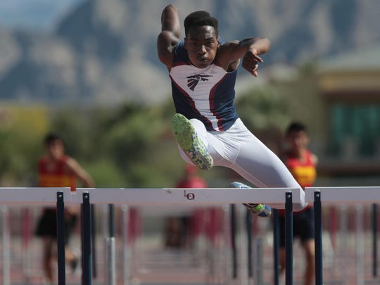 La Quinta's Koty Burton wins the boys' 110 hurdles Thursday during a meet against Palm Desert.