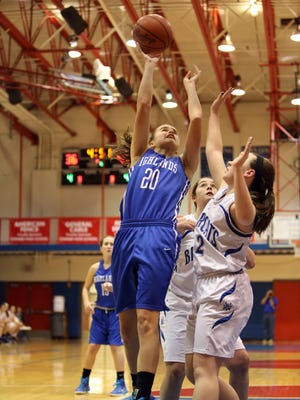 Highlands G Lydia Graves scores from in the paint. Highlands defeated Walton Verona 45-42.