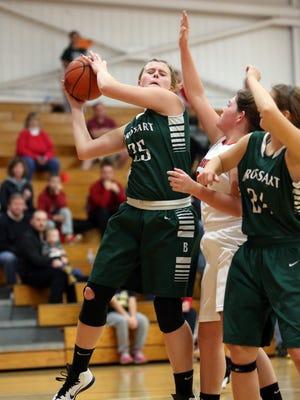 Bishop Brossart's Emily Schultz grabs a rebound.