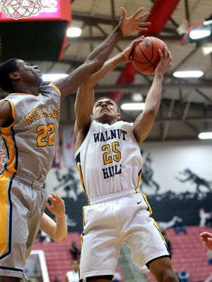 Walnut Hills G MaCio Teague [25] scores in the Boys Sectional Playoff game at Fairfield High School, March 6, 2015. Teague led all scorers with 20 points but Moeller defeated Walnut Hills 48-40.