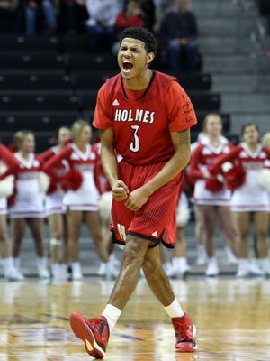 Holmes guard James Bolden reacts after hitting a three-point shot in the boys regional semifinal game between Dixie Heights and Holmes at the Bank Of Kentucky Center in Highland Heights, Kentucky. Holmes defeated Dixie Heights 56-55.