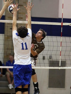 Roger Bacon's Bobby Wilking tries to get a shot by St. Xavier's Cole Bretl in a match May 15.