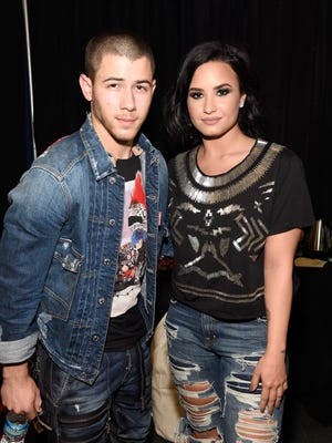 ATLANTA, GA - JUNE 29:  (Exclusive Coverage) Nick Jonas and Demi Lovato pose for a photo backstage during the kick off of the 2016 Honda Civic Tour: Future Now at at Philips Arena on June 29, 2016 in Atlanta, Georgia.  (Photo by Kevin Mazur/Getty Images for Philly Mack)