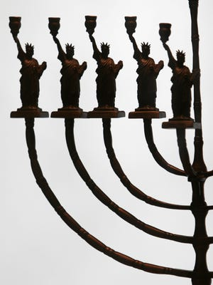 This is a menorah created by Manfred Anson for the 1986 centennial of the Statue of Liberty on display at the Museum of Jewish Heritage in Manhattan Jan. 25, 2005.