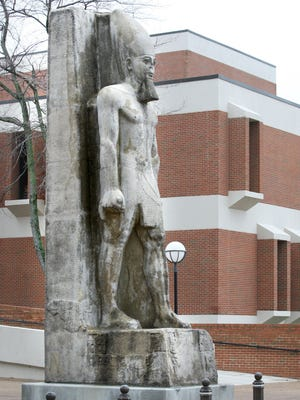"""The Ramesses statue, a 25-foot-tall, 5,000-pound fiberglass reproduction of the limestone original, was moved from The Pyramid, where it had been since 1991 to its new home on the University of Memphis campus between the music and theater buildings on Central Avenue. Ramesses first drew crowds in Memphis during the """"Ramesses The Great"""" exhibit in 1987. City officials found the original statue in pieces in Egypt. It was refurbished by Coca-Cola and became the centerpiece of the exhibit. Several years later the city was given permission by the Egyptian government to reproduce the statue. With Bass Pro Shops taking over The Pyramid, the statue had to be moved. The Memphis City Council voted to send it to the U of M and a donor will cover the $1-a-year lease."""
