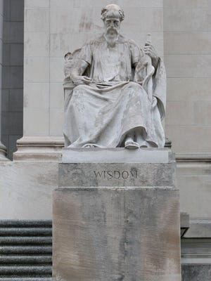 Exterior statuary at the Shelby County Courthouse includes most prominently six figures carved from single blocks of Tennessee marble. This one represents Wisdom.