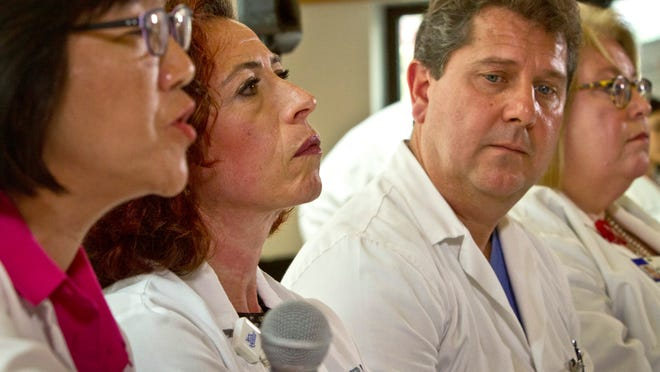 New York Queens Hospital officials from left, Mimi Lim, Dr. Sorana Segal-Maurer, Dr. Mark Kindschuh and Suzanne Pugh hold a press conference on Tuesday.