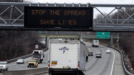 Signs on the New York State Thruway in Spring Valley on Tuesday, March 17, 2020 warning drivers to flatten the curve, stay home and stop the spread, save lives.