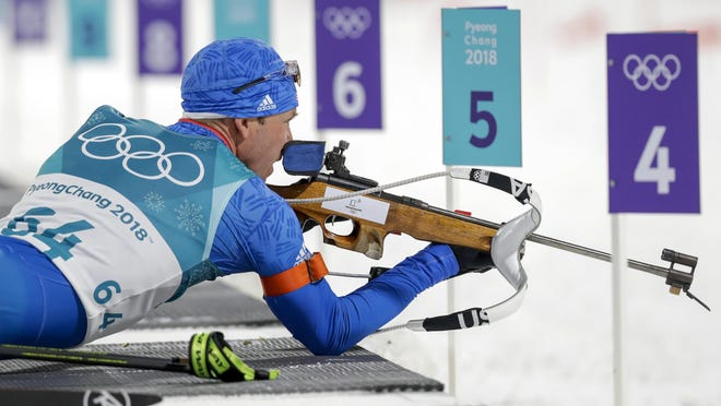 Lowell Bailey, a University of Vermont graduate, looks at the targets before shooting during the men's 10-kilometer biathlon sprint Feb. 11, 2018 at the 2018 Winter Olympics in South Korea.