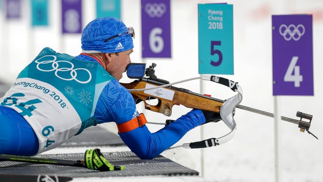 American biathlete Lowell Bailey looks at the targets before shooting during the men's 10-kilometer biathlon sprint.