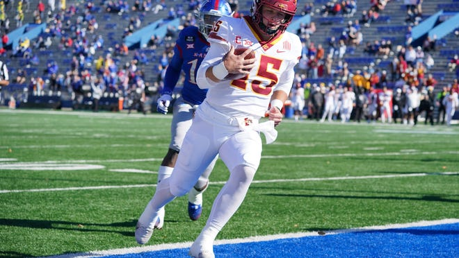 Iowa State quarterback Brock Purdy runs in for a touchdown as Kansas linebacker Steven Parker (14) gives chase during the first half of Saturday's game at David Booth Kansas Memorial Stadium in Lawrence. The No. 23-ranked Cyclones won, 52-22.