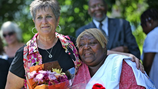 "Lou Ann Beeson (left) and Helen Yeakey are honored at a ""Stop the Violence"" picnic in Denver Park on Sunday, July 12, 2015. Yeakey has lost several family members to gun violence, including her 20-year-old grandson, Tavin T. Yeakey, whose funeral was the day before this gathering. Beeson helped to put on the event."