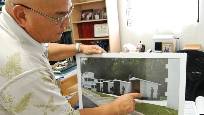 In this August 2013  file photo, former Guam Office of Veterans Affairs Administrator John Unpingco shows an artist's rendition of columbariums for the Guam Veterans Cemetery. An audit report released Thursday, for the period between October 2011 and May 2016, questions the management of non-appropriated funds by Veterans Affairs.