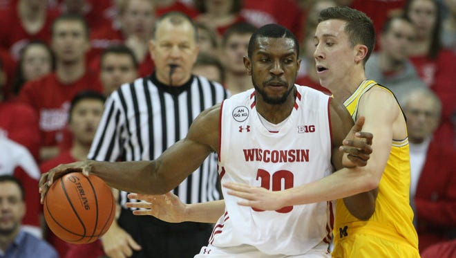 Wisconsin forward Vitto Brown backs down Michigan guard Duncan Robinson during a recent 68-64 victory at the Kohl Center.