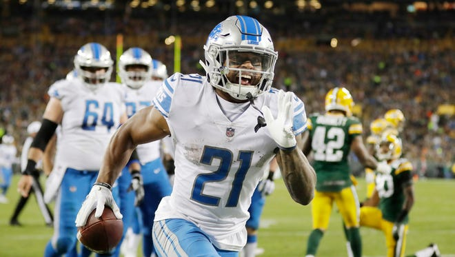 Lions running back Ameer Abdullah celebrates after scoring a touchdown against the Packers in the second quarter at Lambeau Field, Nov. 6, 2017 in Green Bay.